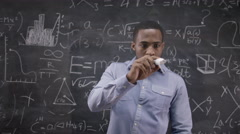 4K Academic man writing math formula on glass screen in front of camera  Stock Footage
