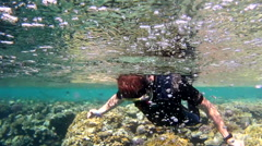 Young man snorkeling in the Red sea Stock Footage