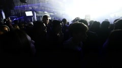 People with drinks dance in crowded nightclub. Slow motion. Strobe Stock Footage