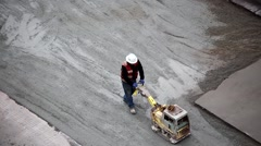 Top shot of worker paving the road Stock Footage