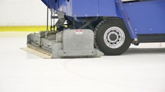 Big blue ice resurfacer truck polishes ice rink - stock footage