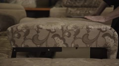 Man folding pattern sofa in furniture factory Stock Footage