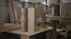 Man stay ready part of furniture made from wood on a table on factory Stock Footage
