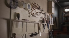 View of a wall with different work instruments in furniture factory Stock Footage