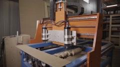 Turning lathe handles wooden block in furniture factory Stock Footage