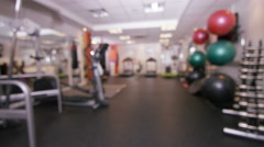 4K Interior view of modern gym with machines & equipment. No people Stock Footage