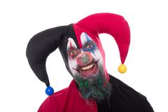 Portrait of a funny jester, isolated on white Stock Photos