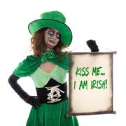 Leprechaun girl holding a scoll with text Kiss me i am irish, isolated on whi - stock photo