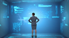 Businesswoman coding on tech interface - stock footage