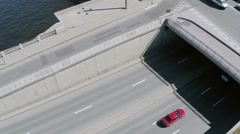 Quadrocopter shoot bridge with traffic and river in summer day. Slow motion Stock Footage