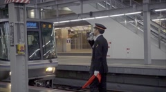 Station master of Japan Railway on duty in subway station Stock Footage