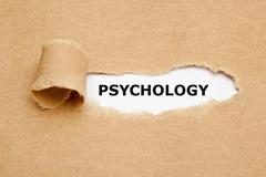 Psychology Torn Paper Concept - stock photo