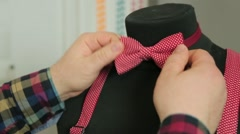 Red bow-tie on a mannequin Stock Footage