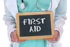 First aid help helping cpr doctor medical accident - stock photo