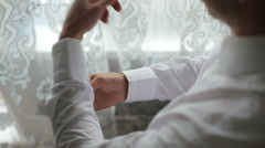 Man buttoning on sleeve shirt Stock Footage