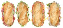 Collection of sub sandwiches baguettes with salami, ham and cheese top view i Stock Photos