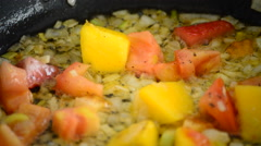 Cooking in a hot pan with mango, tomato, strawberry and onion Stock Footage