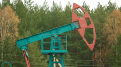 Oil Industry Pumpjack in forest Russia - stock footage
