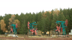 Oil Industry Pump jacks in forest - stock footage