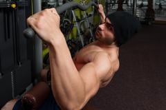 Young Bodybuilder Doing Heavy Weight Exercise For Back Stock Photos