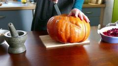 Cut a large pumpkin Stock Footage