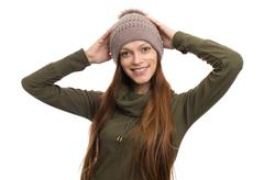 Woman wearing Fleece Coat and hat - stock photo