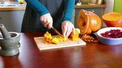 Cut a large pumpkin - stock footage