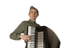 Soviet soldier playing the accordion over white background - stock photo