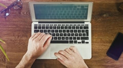 Flat Lay - Man with Laptop on desktop typing Stock Footage