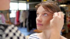 Stock Video Footage of Makeup artist making up model closeup