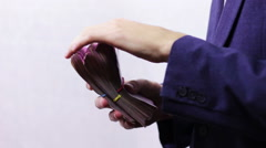 Businessman with Wads of Money in Hands - stock footage
