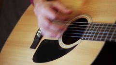 Musician playing on acoustic guitar. Close-up. - stock footage