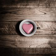 Pink heart ceramic in coffee cup Stock Photos