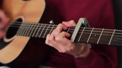 A handsome musician playing guitar. Acoustic concert. - stock footage