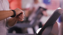 4K Woman working out on machine at the gym with personal fitness instructor - stock footage