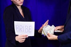 Man gives a bribe - stock photo