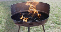 Blazing fire in a portable barbecue Stock Footage