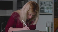 Stock Video Footage of Woman Working on iPad Pro in House Medium Shot