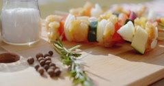 Four vegetable kabobs on cutting board Stock Footage