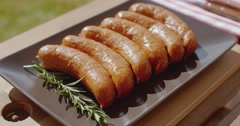Smoked sausages and rosemary Stock Footage