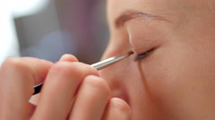 Makeup brush on eye close up - stock footage