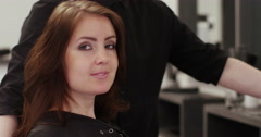 A happy young woman after having her hair groomed at her local salon. Stock Footage