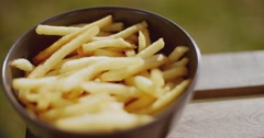 Bowl of freshly fried potato chips - stock footage