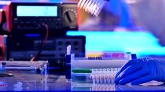 Sample preparation for DNA electrophoresis. Adding samples in Gel - stock footage