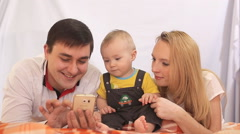 Happy Family looking at photo on phone - stock footage