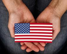 Woman holding American flag on her palms Stock Photos