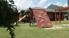 A boy climbing and jumping around on a playground Stock Footage