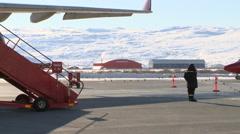 Pan to Dash 8 propeller plane warming up Stock Footage
