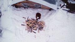 Overhead Aerial Video of Lumberjack Splitting Wood Logs Stock Footage