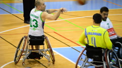 Players of wheelchair basketball playing a game Stock Footage